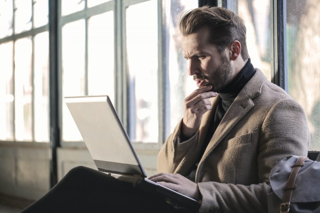 a professional in brown jacket searching for a resume sample