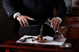 wine sales maanger preparing wine for clients