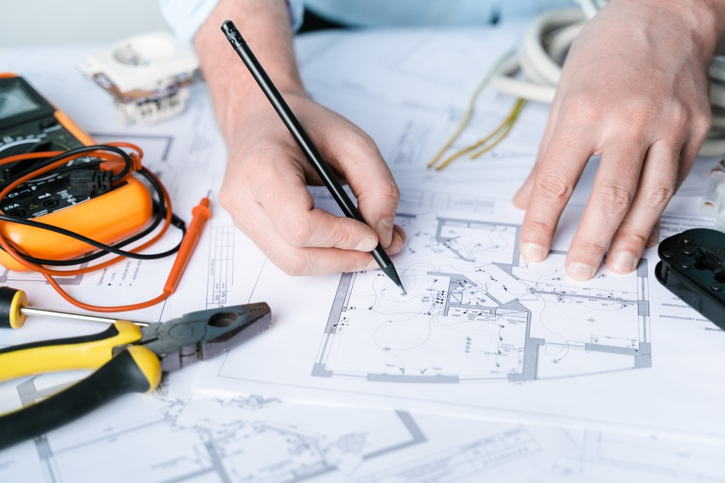 electrical engineer working with blueprint