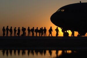 people boarding an airplane depicting soldiers preparing for life in the civilian setting—hence the need for military resume writing services
