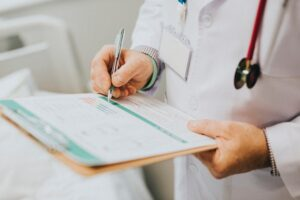 Part of the medical assistant job description is maintaining patient records for proper perusal.