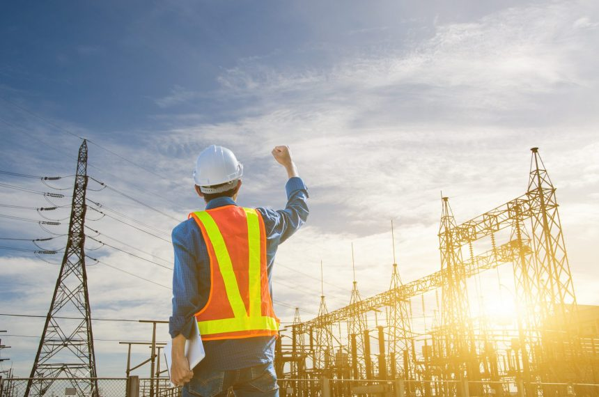 Happy man on site with an effective construction project manager resume