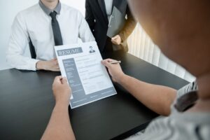 a hiring manager reviews the applicant's resume, made by online resume maker