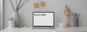minimalist workspace, with a laptop in the middle that displays the words 'resume maker' on the screen